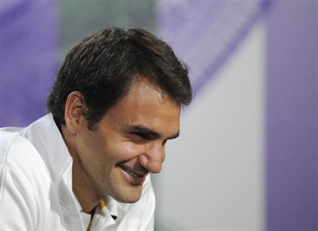 Roger Federer of Switzerland speaks at a news conference the day before the start of the the Wimbledon Tennis Championships, in London June 23, 2013. REUTERS/Jon Buckle/AELTC/Pool