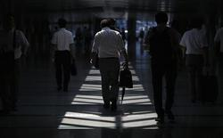 Businessmen walk in a convention centre in Tokyo July 18, 2013.REUTERS/Toru Hanai