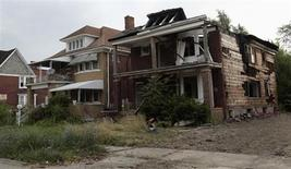 A vacant blighted home is seen next to a well-kept occupied home on West Grand Boulevard in Detroit, Michigan July 23, 2013. REUTERS/ Rebecca Cook