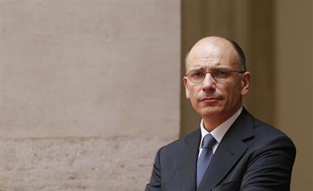 taly's Prime Minister Enrico Letta looks on as he stands in the courtyard of Chigi Palace in Rome July 4, 2013. REUTERS/Tony Gentile