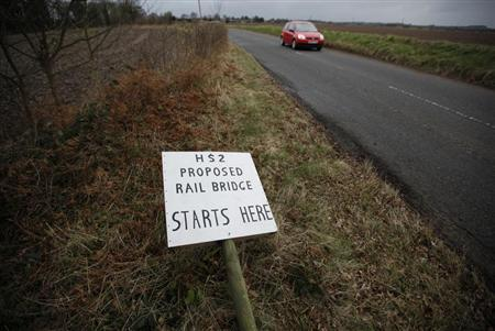 An anti-HS2 sign lies in the floor on the planned route of the new HS2 high speed rail link in Middleton, central England, March 15, 2013. REUTERS/Darren Staples