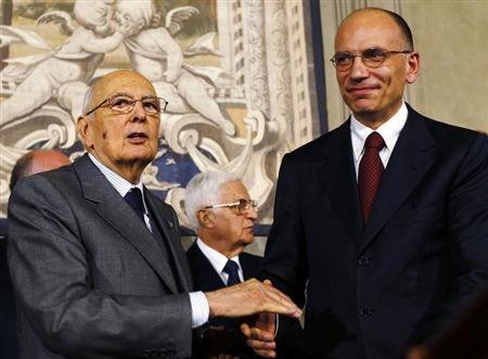 Italian Prime Minister-designate and deputy leader of the centre-left Democratic Party (PD) Enrico Letta (R) shakes hands with President Giorgio Napolitano at the Quirinale Palace in Rome, April 27, 2013. REUTERS/Alessandro Bianchi