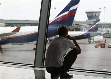 A man waits in the transit zone of terminal F at Sheremetyevo airport in Moscow July 12, 2013. REUTERS/Sergei Karpukhin