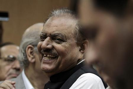 Mamnoon Hussain, presidential candidate of the Pakistan Muslim League-Nawaz (PML-N) party, smiles as he submits his nomination papers for the upcoming presidential election at the High Court in Islamabad July 24, 2013. REUTERS/Faisal Mahmood