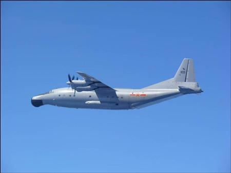 A Chinese military plane Y-8 airborne early warning plane flies through airspace between Okinawa prefecture's main island and the smaller Miyako island in southern Japan, out over the Pacific, in this handout photo taken July 24, 2013 by Japan Air Self-Defence Force and released by the Joint Staff Office of the Defense Ministry of Japan. REUTERS/Joint Staff Office of the Defense Ministry of Japan/Handout via Reuters