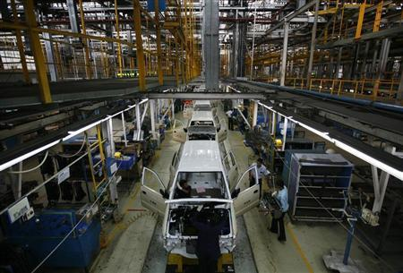 Employees work on the Chevrolet Tavera compact MPV assembly line inside a plant of General Motors India Ltd. at Halol, east of the western Indian city of Ahmedabad, September 22, 2010. REUTERS/Amit Dave