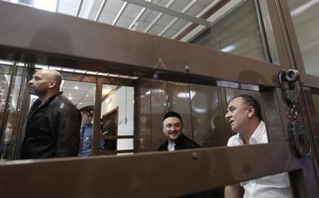 Defendants in the murder trial of Russian journalist and human rights activist Anna Politkovskaya, Rustam Makhmudov (C), Sergei Khadzhikurbanov (L) and Lom-Ali Gaitukayev attend a court hearing in Moscow, June 3, 2013. REUTERS/Maxim Shemetov