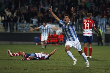 Malaga's Javier Saviola celebrates after scoring a goal against Granada during their Spanish First Division soccer match at La Rosaleda stadium in Malaga, southern Spain in this December 8, 2012 file photo. REUTERS/Jon Nazca/Files