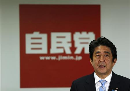 Japan's Prime Minister and the leader of the ruling Liberal Democratic Party (LDP), Shinzo Abe, speaks during a news conference following a victory in the upper house elections by his ruling coalition, at the LDP headquarters in Tokyo July 22, 2013 file photo.REUTERS/Issei Kato