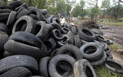 A pile of illegally dumped tires is seen during a blight removal project in the Brightmoor neighborhood in Detroit, Michigan July 16, 2013. Picture taken July 16, 2013. REUTERS/ Rebecca Cook