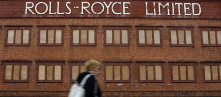 A woman walks past a closed Rolls Royce building in Derby, central England, November 20, 2008. REUTERS/Darren Staples