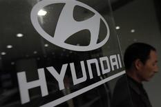 A visitor walks past a Hyundai Motor logo at a Hyundai dealership in Seoul April 25, 2013. REUTERS/Kim Hong-Ji