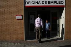 People stand in a government-run employment office in Madrid July 25, 2013. REUTERS/Juan Medina