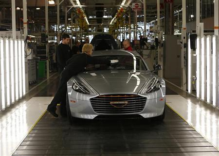 Workers inspect an Aston Martin Rapide S at their production facility in Gaydon, central England February 28, 2013. REUTERS/Darren Staples