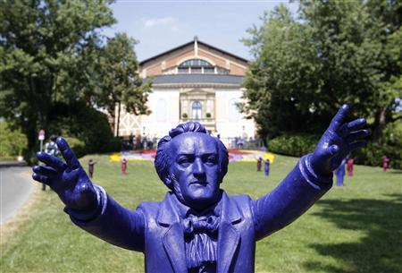 Sculptures of German composer Richard Wagner are seen outside the Gruener Huegel (Green Hill) opera house in Bayreuth July 25, 2013. REUTERS/Michaela Rehle