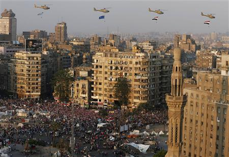 A view shows a fly-past over protesters against ousted Egyptian President Mohamed Mursi, in Tahrir Square in Cairo in this July 4, 2013 file photo. REUTERS/Steve Crisp/Files