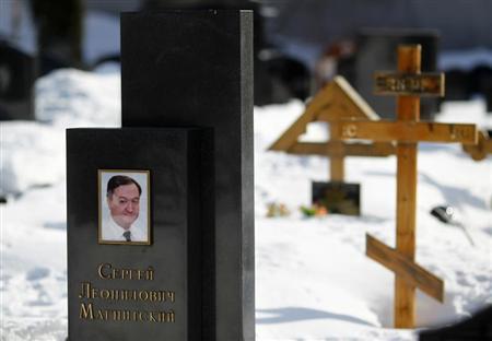 A picture of lawyer Sergei Magnitsky is seen on his grave in the Preobrazhensky cemetery in Moscow March 11, 2013. REUTERS/Mikhail Voskresensky