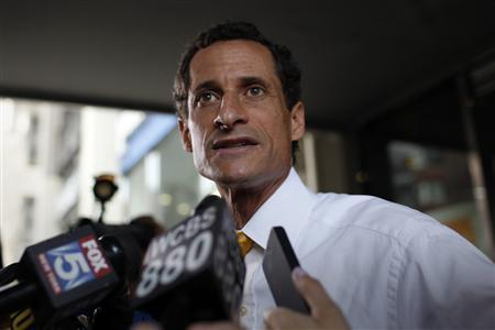 Former U.S. congressman from New York and current Democratic candidate for New York City Mayor Anthony Weiner stops to speak to the media outside his New York City apartment July 24, 2013. REUTERS/Mike Segar