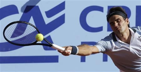 Switzerland's Roger Federer returns the ball to Germany's Daniel Brands during their Swiss Open second round tennis match in Gstaad July 25, 2013. REUTERS/Denis Balibouse