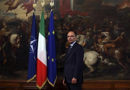 Italy's Prime Minister Enrico Letta stands as he waits for NATO Secretary General Anders Fogh Rasmussen in Rome July 25, 2013. REUTERS/Alessandro Bianchi