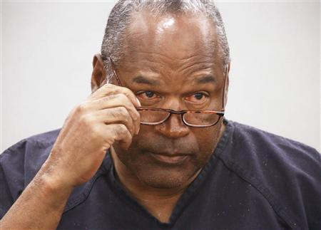O.J. Simpson takes his glasses off during his evidentiary hearing testimony in Clark County District Court in Las Vegas, Nevada in this May 15, 2013 file photo. REUTERS/Jeff Scheid/Pool/Files