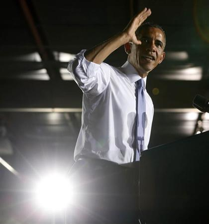 U.S. President Barack Obama gestures while he speaks about the U.S. economy inside the main warehouse at the Jacksonville Port in Florida, July 25, 2013. REUTERS/Larry Downing