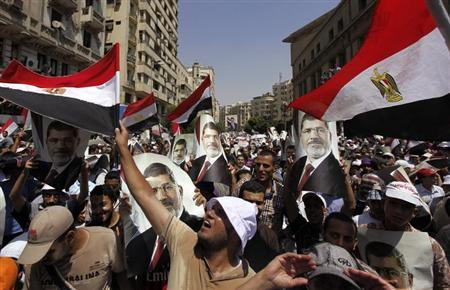 Members of the Muslim Brotherhood and supporters of ousted Egyptian President Mohamed Mursi shout slogans and close the roads during a protest in downtown Cairo July 22, 2013. REUTERS/Amr Abdallah Dalsh