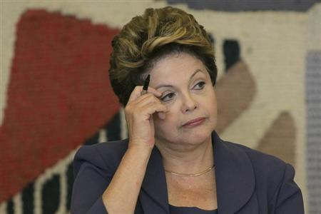 Brazil's President Dilma Rousseff reacts during the plenary meeting for the Council of Economic and Social Development at Itamaraty Palace in Brasilia July 17, 2013. REUTERS/Ueslei Marcelino
