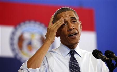 U.S. President Barack Obama wipes his brow while speaking in a hot room about the economy during a trip to the University of Central Missouri in Warrenburg, Missouri July 24, 2013. REUTERS/Kevin Lamarque