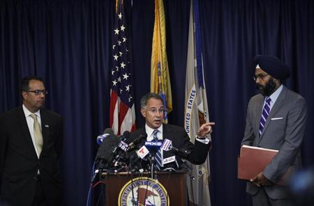 New Jersey U.S. Attorney Paul J. Fishman (C) speaks to the media next to U.S. Secret Service Special Agent James Mottola (L) and assistant New Jersey Attorney Gurbir Grewal during a news conference in Newark, New Jersey, July 25, 2013. REUTERS/Eduardo Munoz