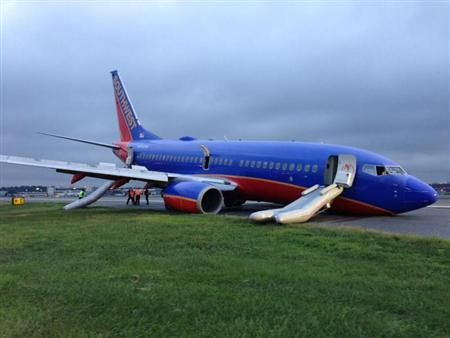 A Southwest Boeing 737 aeroplane sits on the tarmac after passengers were evacuated, at LaGuardia Airport in New York, in this photo courtesy of the National Transportation Safety Board (NTSB) made available July 23, 2013. REUTERS/NTSB/Handout via Reuters