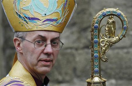 The new Archbishop of Canterbury Justin Welby leaves after his enthronement ceremony at Canterbury Cathedral, in Canterbury, southern England March 21, 2013. REUTERS/Luke MacGregor