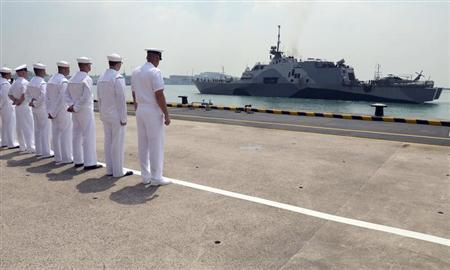 U.S. Navy sailors look at the littoral combat ship USS Freedom as it arrives in Changi Naval Base in this April 18, 2013 photo provided by the U.S. Navy. REUTERS/U.S. Navy/Mass Communications Specialist 1st Class Jay C. Pugh/Handout