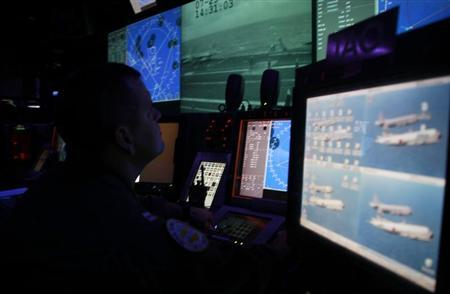 U.S. Navy personnel work in the control room of the USS George Washington aircraft carrier off the coast of Brisbane July 23, 2013. REUTERS/Lincoln Feast