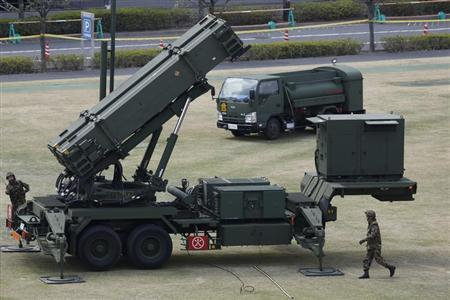 Japan Self-Defence Forces soldiers prepare to refuel a unit of Patriot Advanced Capability-3 (PAC-3) missiles at the Defence Ministry in Tokyo April 10, 2013. REUTERS/Issei Kato
