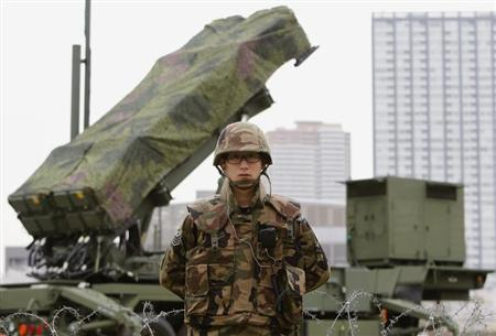 A Japanese Self-Defence Force soldier stands guard near Patriot Advanced Capability-3 (PAC-3) land-to-air missiles at the Defence Ministry in Tokyo April 10, 2012. REUTERS/Toru Hanai/Files