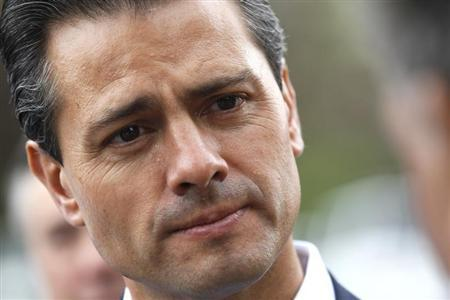 Mexican President Enrique Pena Nieto listens to an attendee at the annual Allen and Co. conference at the Sun Valley, Idaho Resort July 11, 2013. REUTERS/Rick Wilking