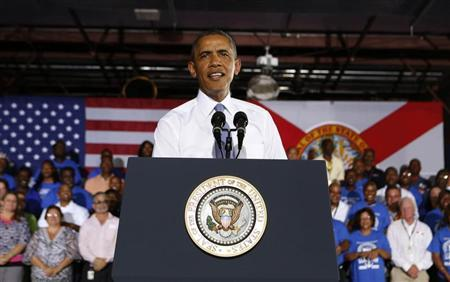 U.S. President Barack Obama speaks about the U.S. economy inside the main warehouse at the Jacksonville Port in Florida, July 25, 2013. REUTERS/Larry Downing