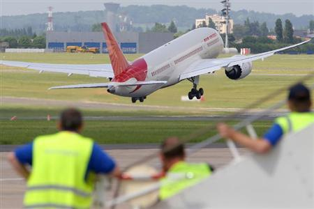 An Air India Airlines Boeing 787 dreamliner takes off for a flying display during the 50th Paris Air Show at the Le Bourget airport near Paris, June 14, 2013. REUTERS/Pascal Rossignol/Files