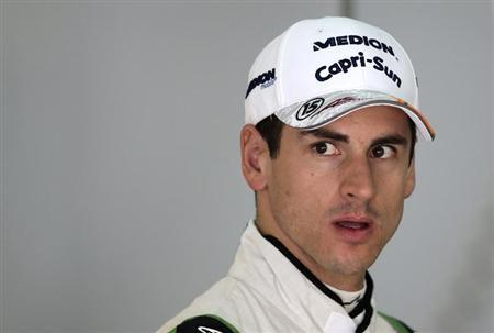 Force India Formula One driver Adrian Sutil of Germany walks in the garage during the first practice session of the Malaysian F1 Grand Prix at Sepang International Circuit outside Kuala Lumpur, March 22, 2013. REUTERS/Tim