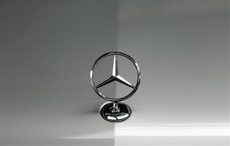 File photo of the bonnet emblem of a Mercedes-Benz car is pictured in a dealership of German car manufacturer Daimler in Munich May 17, 2013. REUTERS/Michaela Rehle/Files