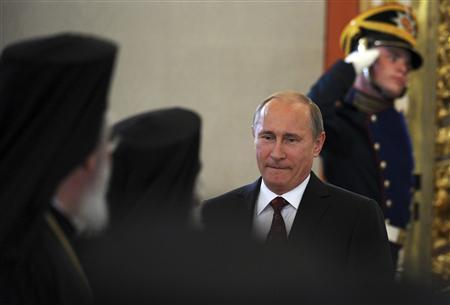 Russian President Vladimir Putin arrives for a meeting with Russian Orthodox church officials in Moscow's Kremlin July 25, 2013. REUTERS/Alexander Nemenov/Pool