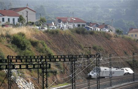 The train engine is seen at the site of a train crash in Santiago de Compostela, northwestern Spain, July 26, 2013. REUTERS/Miguel Vidal