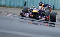 Sebastian Vettel, da Red Bull, durante segunda sessão de treinos livres para o Grande Prêmio da Hungria de Fórmula 1, no circuito de Hungaroring, em Mogyorod, perto de Budapeste, nesta sexta-feiram 26 de julho de 2013. REUTERS/Laszlo Balogh