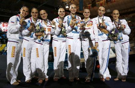 Russia's team show their gold medals after winning the synchronized swimming team free final during the World Swimming Championships at the Sant Jordi arena in Barcelona July 26, 2013. REUTERS/Albert Gea