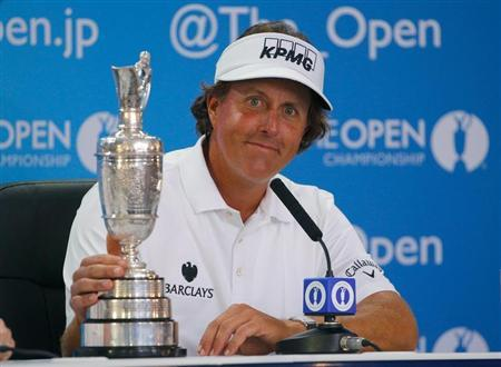 Phil Mickelson of the U.S. sits with the Claret Jug at a press conference after winning the British Open golf championship at Muirfield in Scotland July 21, 2013. REUTERS/Brian Snyder
