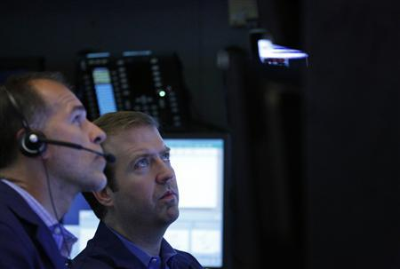 Traders work on the floor of the New York Stock Exchange, July 26, 2013. REUTERS/Brendan McDermid