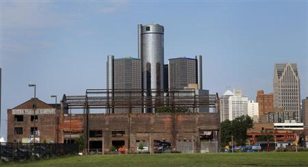 General Motors World Headquarters is seen behind a historic warehouse being restored along the Detroit River in Detroit, Michigan July 21, 2013. REUTERS/ Rebecca Cook