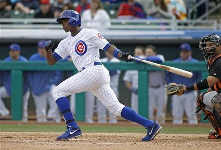Chicago Cubs' Alfonso Soriano lines a single to the outfield against the San Francisco Giants during their MLB Cactus League spring training baseball game in Mesa, Arizona, February 24, 2013. REUTERS/Ralph D. Freso