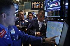 Traders work on the floor of the New York Stock Exchange, July 26, 2013. REUTERS/Brendan McDermid